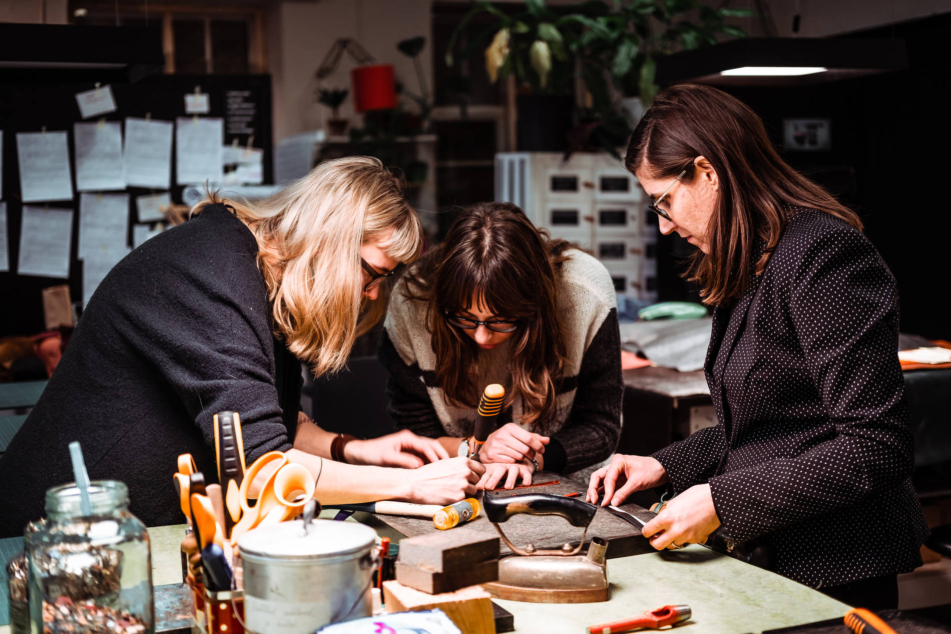 People crafting with leather at the Stella Soomlais leather workshop. Photo by: Kadi-Liis Koppel