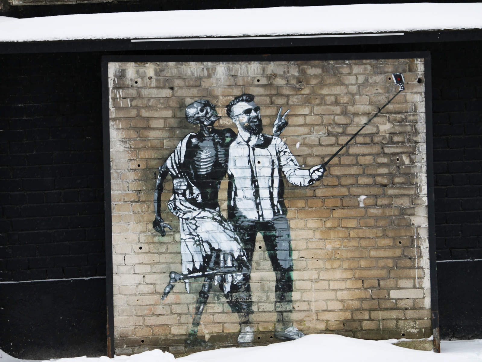 A hipster taking a selfie with a skeleton - street art by Edward von Lõngus in Tallinn, Estonia.  Photo: Mairit Krabbi
