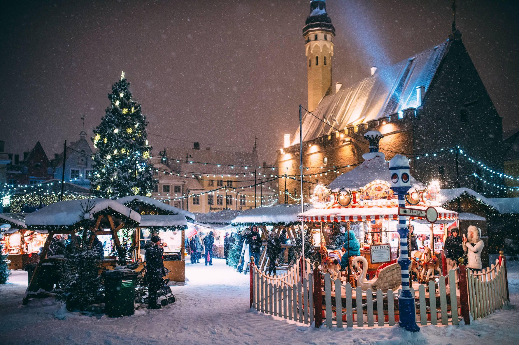 View of the Christmas market including the Christmas tree and carrousel on the Town Hall Square in the Old Town of Tallinn, Estonia. Photo: Jake Farra