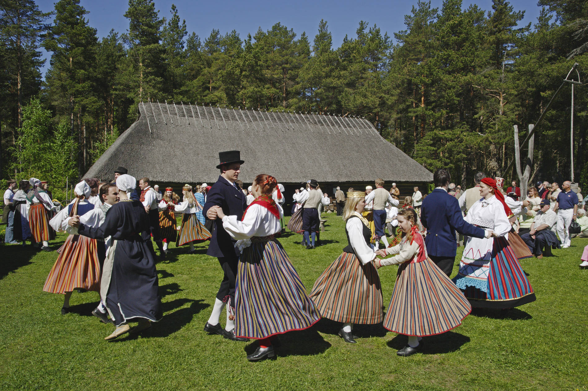 Folk dancers performing in front of an old tavern in the Open Air museum in the Rocca al Mare area Tallinn, Estonia. Photo by: Toomas Tuul