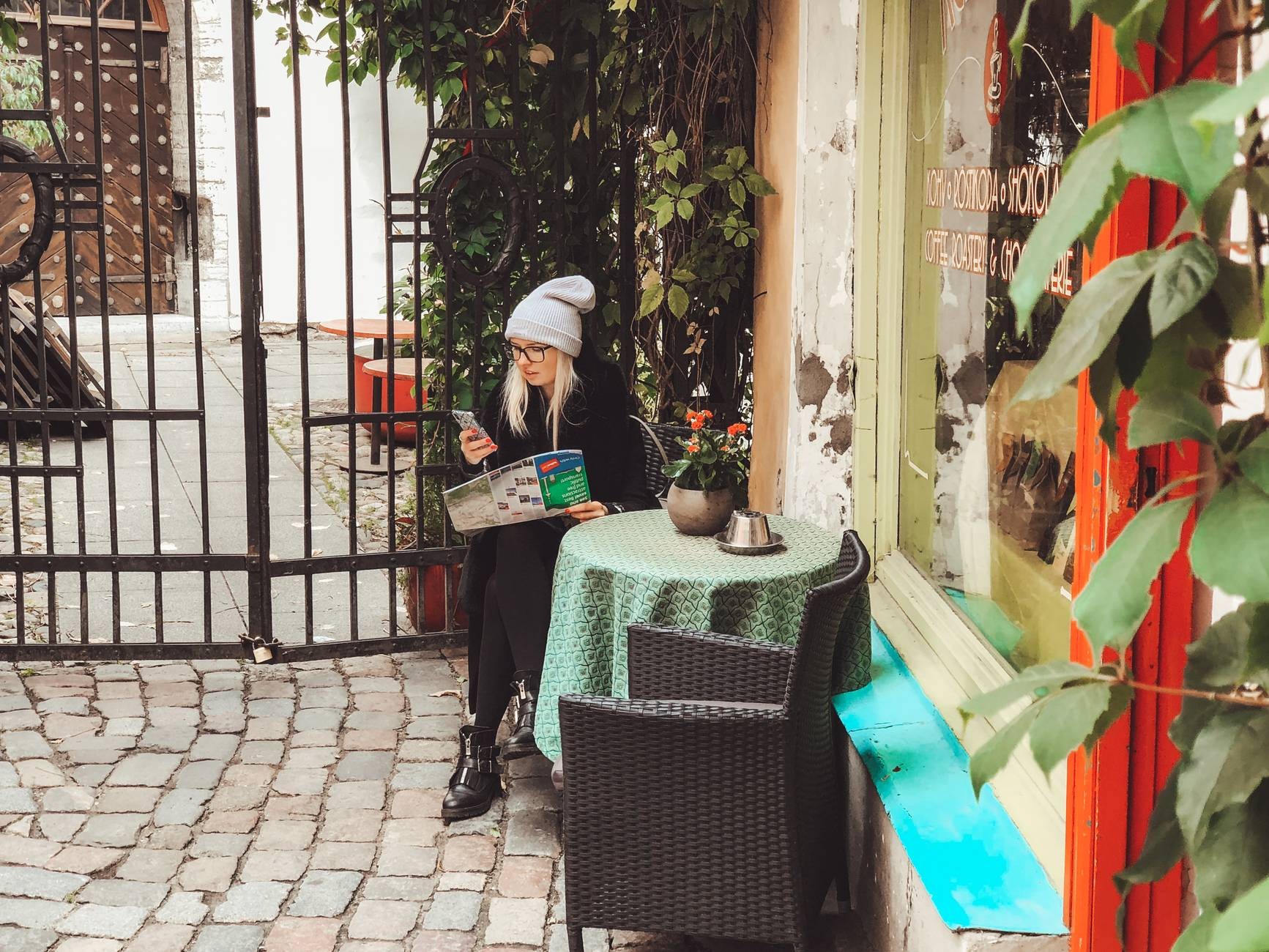 Woman at  the Old Town of Tallinn, Estonia, looking at a map of the city.  Photo: Kadi-Liis Koppel